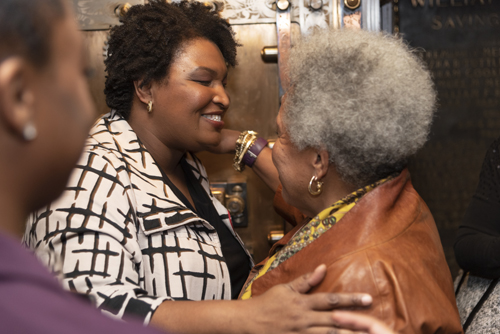 Stacey Abrams and Lola C. West embrace at the Foundation's 2019 Invest in Brooklyn Dinner.